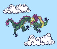 Chinese Dragon. In the sky with chinese style clouds Stock Images