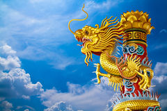 Chinese Dragon. As temple's decoration on blue sky Royalty Free Stock Image