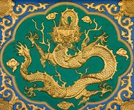 Chinese Dragon. Chinese golden dragon at the wall Stock Photo
