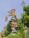 Chinese dragon around red column in blue sky Stock Photography