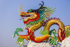 Chinese dragon and blue sky. Chinese dragon on blue background Stock Photos