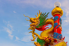 Chinese dragon on blue sky background stock photo