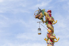 Chinese dragon on blue sky Royalty Free Stock Photos