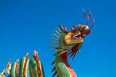 Chinese Dragon on the blue sky. Royalty Free Stock Image