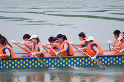 Chinese dragon boat with women stock photo