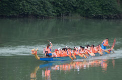Chinese dragon boat with women's team Royalty Free Stock Photography
