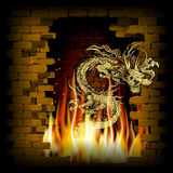 Chinese dragon on a brick background fire Stock Photo