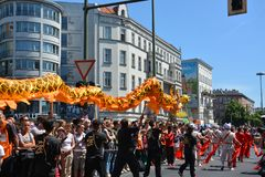 Chinese dragon brought through the streets of Berlin during the peoples` carnival stock photos