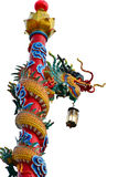 Chinese Dragon carrying a lamp. Chinese dragon statue isolated on the white backgroun Royalty Free Stock Photos