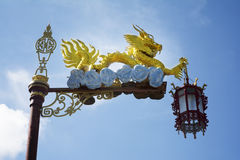 Chinese dragon on column in blue sky with chinese lamp Stock Photos