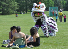 Chinese Dragon Dancers  and People in Park Royalty Free Stock Images