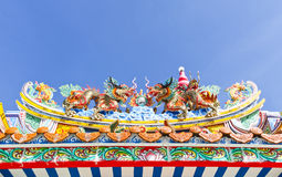 Chinese dragon decoration on the roof against blue sky Stock Images