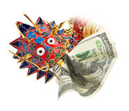 Chinese dragon with dollar. Close-up of Chinese enameled dragon head with American dollar in mouth. Dragon devours dollar Stock Photo