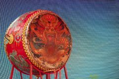 Chinese Dragon Drum. A Chinese drum with a picture a dragon on it against a blue pixelated background royalty free stock photo
