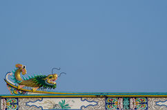 Chinese dragon. Gold chinese dragon statue on roof Stock Photo