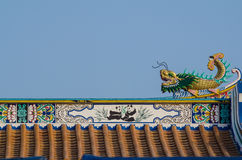 Chinese dragon. Gold chinese dragon statue on roof Royalty Free Stock Images