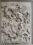 Chinese Dragon Granite Stone Carving. On Temple Outside Wall royalty free stock photos