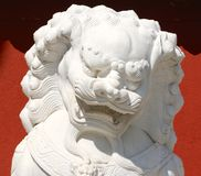 Chinese Stone Lion. S are legendary creatures in Chinese mythology and Chinese folklore. The dragons have many animal-like forms such as turtles, fish, and Royalty Free Stock Image