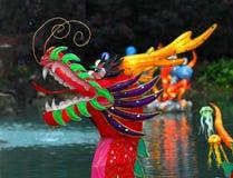 Chinese Dragon (Illuminated). Portrait of an Illuminated Chinese Dragon on a lake Royalty Free Stock Photos