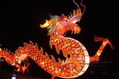 Chinese dragon lantern. A huge chinese dragon lantern lighting up in the night stock images