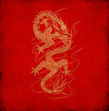 Chinese dragon on old red paper Stock Images