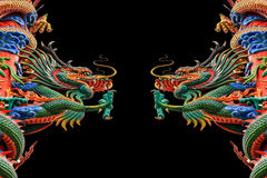 Chinese dragon with open mounth against a black background. Royalty Free Stock Image