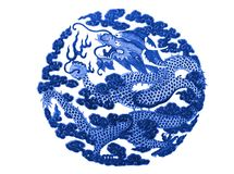 Chinese dragon painted on a ceramic vase. With cobalt blue glaze royalty free stock image