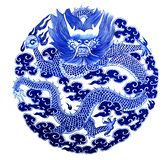 Chinese dragon painted on a ceramic vase. With cobalt blue glaze royalty free stock photos