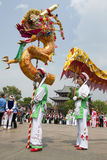 Chinese Dragon Parade. Bai ethnic minority people dance in a dragon parade for the opening ceremony of the Third Month Fair in Dali, Yunnan province, China Royalty Free Stock Photography