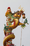 Chinese dragon on the pole in beautiful Chinese shrine. Royalty Free Stock Images