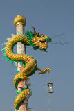 Chinese dragon on the pole in beautiful Chinese shrine. Royalty Free Stock Photography