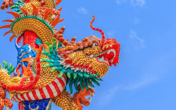 Chinese dragon on the pole. This colorful Chinese dragon on the pole image is taken from a public Chinese shrine Stock Photos
