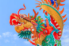 Chinese dragon on the pole. This colorful Chinese dragon on the pole image is taken from a public Chinese shrine Stock Images