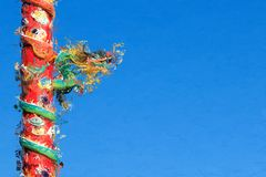 Chinese Dragon on Red Pillar on Blue Background, Processed in Pa Stock Photo