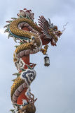 Chinese dragon. On the red pole Royalty Free Stock Photos