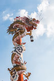 Chinese dragon on the red pole at Wat Phananchoeng Stock Photo