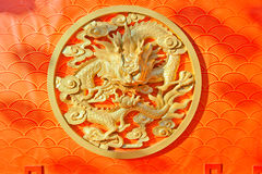 Chinese dragon relief pattern. Golden Chinese dragon relief on traditional Chinese pattern background royalty free stock image