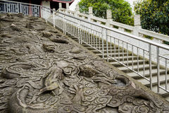 Chinese dragon relief on slope,Chengdu Stock Photo