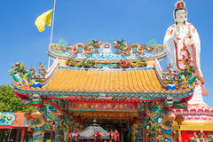 Chinese dragon on the roof and guanyin with blue sky Royalty Free Stock Images
