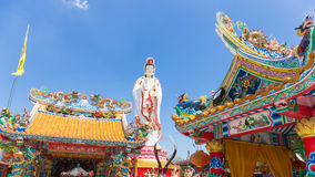 Chinese dragon on the roof and guanyin with blue sky Stock Photos
