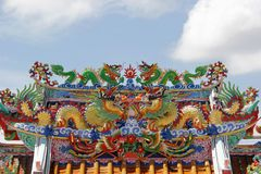 Chinese dragon on the roof of shrine. With beautiful sky background royalty free stock photography