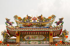 Chinese dragon on the roof of a shrine in Thailand. The Chinese dragon on the roof of a shrine in Thailand royalty free stock photos