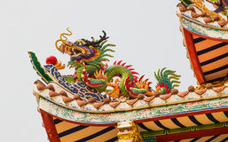 Chinese dragon on the roof of a shrine in Thailand. The Chinese dragon on the roof of a shrine in Thailand stock photo