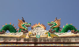 Chinese dragon on the roof of a shrine in Thailand. The Chinese dragon on the roof of a shrine in Thailand royalty free stock images