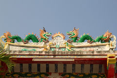 Chinese dragon on the roof of a shrine in Thailand. The Chinese dragon on the roof of a shrine in Thailand stock photos