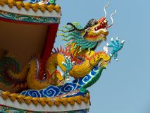 Chinese dragon sculpture on the roof of chinese temple stock photo