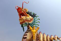 Chinese dragon in shrine with sky background. Chinese dragon in shrine with blue sky background stock image