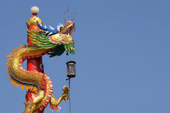 The Chinese dragon statue with blue sky background Royalty Free Stock Photo