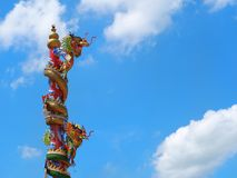 Chinese dragon statue climbing pole Stock Images