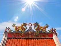 Chinese dragon statue climbing pole Stock Photos